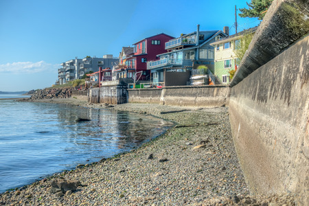 Residences sit above a seawall in West Seattle, Washington. HDR image.