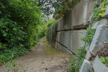 The Indian Trail in Burien, Washington passes by a wall. Stock fotó