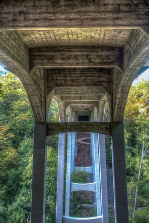 symetry: Aview beneath the bridge at Saltwater State Park in Des Moines, Washington. HDR image.