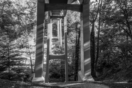 A view from beneath a highway overpass at Saltwaster State Park in Washington State. Black and white.