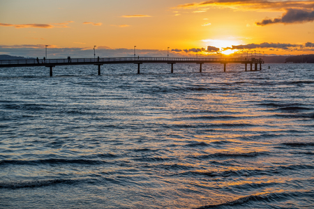 fishing pier: The sun sets behind the fishing pier in Des Moines, Washington.