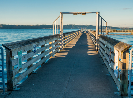 puget: A view of the fishing pier in Dash Point, Washington at high tide. Stock Photo