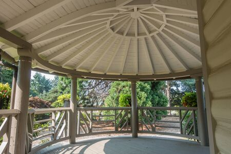 View from a porch  beneath a domed roof.