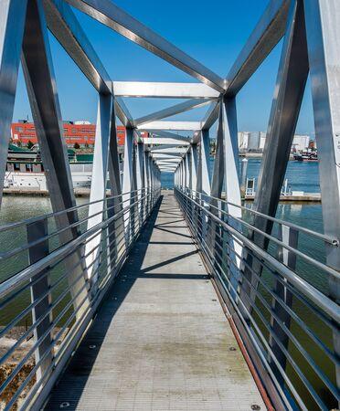 matallic: Geometric shiny ramp at a marina in Rustons Washington near Tacoma.
