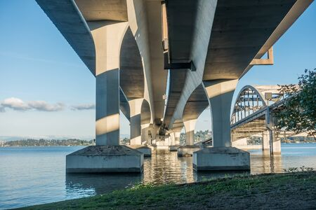 west end: A view from beneath the west end of the Interstate Ninety bridge in Seattle, Washington.