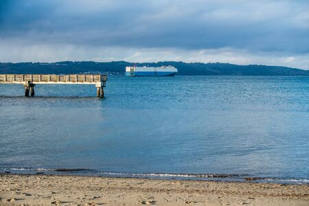puget: A large ship on the Puget Sound passes Dash Point, Washington.