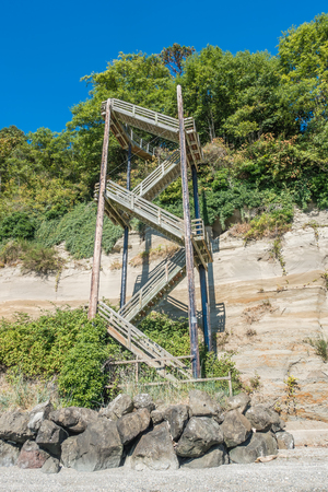 straight up: A vertical staircase rises straight up next to a hill at Saltwater State Park in Des Moines, Washington.