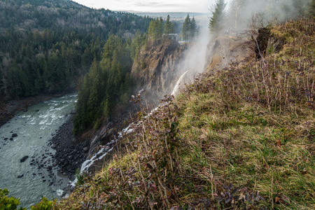 Water blasts from the side of a hill just below Snoqualmie Falls. Banco de Imagens