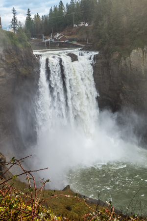 powerfull: A heavy mist rises as Snoqualmie Falls rushes powerfully. Stock Photo