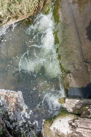 Fresh water flows in a stream at Normandy Park, Washington. Stock Photo