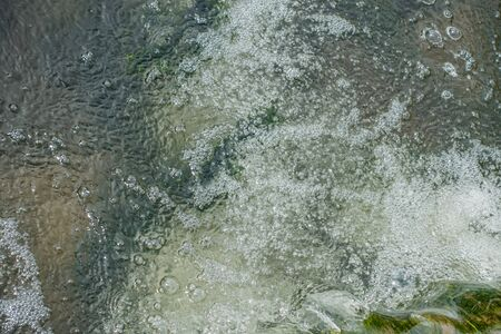 Closeup of churning water in a freshwater stream. Banco de Imagens