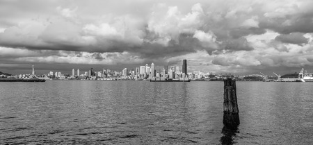 Billowing clouds hover over the Seattle skyline. Black and white image. Stock Photo