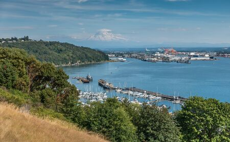 Clouds hover near Mount Rainier with the Port of Tacoma below. Stock Photo