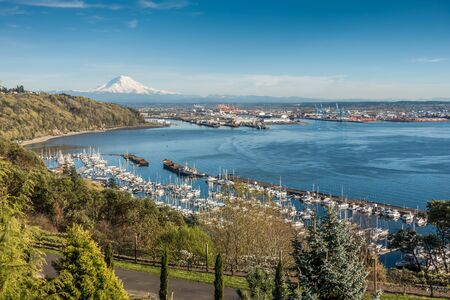 puget: A panoramic view of Mount Rainier, The Port of Tacoma and a marina.