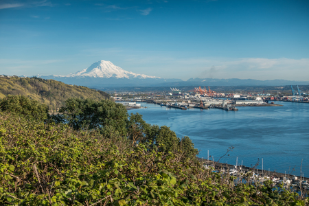 A panoramic view of Mount Rainier, The Port of Tacoma and a marina.