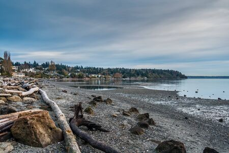 puget: The waters of the Puget Sound are calm along the shoreline of Normandy Park, Washington.