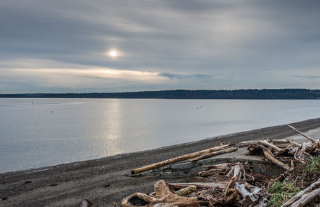 puget: Clouds obscure the sun on and overcast day on the Puget Sound in Washington State.