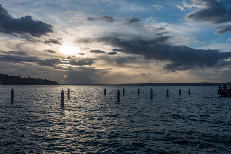 shorelines: The sun sets behind clouds at Redondo Beach, Washington.