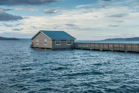 puget: Water has risen to the very top of the pier in Redondo Beach, Washington. Stock Photo