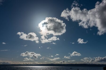 A Pacific Northwest cloud eclipses the sun over the Puget Sound. Stock fotó