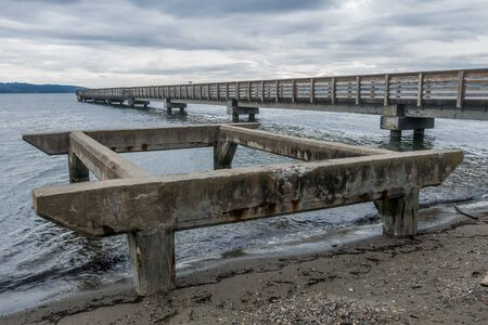 puget: View of the pier at Dash Point, Washington with overcast skies and the Puget Sound.