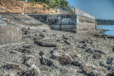 fond marin: Steps lead to the rocky seabed in West Seattle, Washington. HDR image.