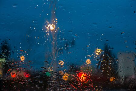 pacific northwest: A veiw through a wet car windshield in the Pacific Northwest.