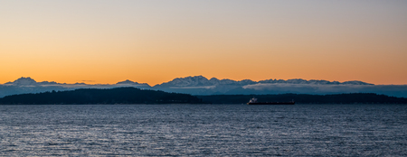 puget: A silhouette of the Olympic Mountains at sunset.  Panoramic shot.