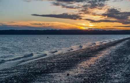 puget: A view of a sunset from Three Tree Point in Burien, Washington.