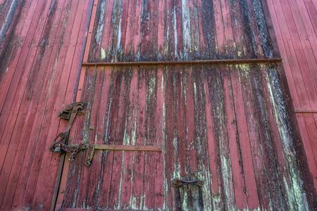 Closeup shot of an old red railway car.