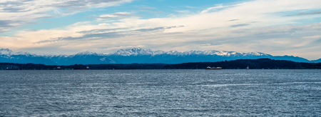 A panorma shot of the snowcapped peaks of the Olympic Mountains in Washington State.