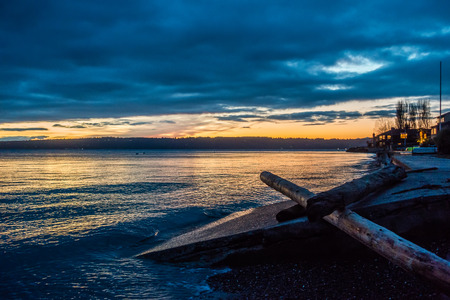 puget: The sun is setting behind the Puget Sound in Washington State.