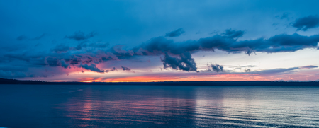 puget: The sun sets behind the Puget Sound in winter. Stock Photo