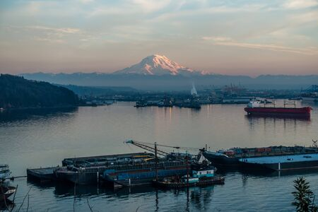 tacoma: A view of the Port of Tacoma and Mount Rainier at sunset.