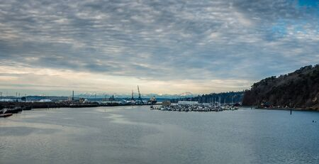 A view of  a Tacoma marina with the Olympic Mountains in the distance. Stock Photo