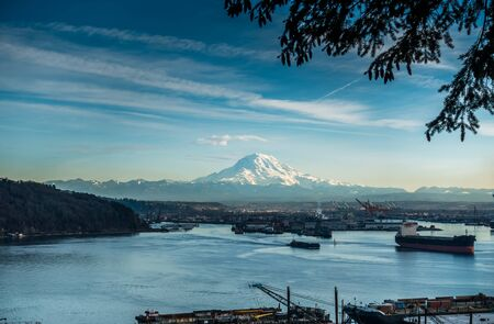 tacoma: A view of moored boats in the Port of Tacoma with Mount Rainier in the distance.