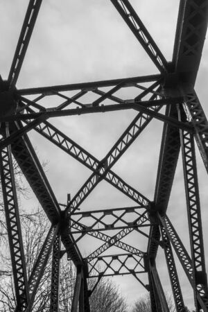 trestle: A view of a silhouette of a bridge trestle that spans the Cedar River in Renton, Washington. Black and white image.