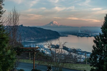 A view of the Port of Tacoma and Mount Rainier at sunset.