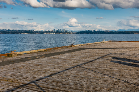 A view of the skyline of Bellevue, Washington with the Cascade Mountains behind. Stock Photo