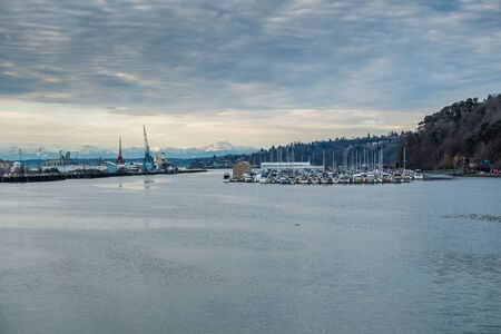 tacoma: A view of  a Tacoma marina with the Olympic Mountains in the distance. Stock Photo