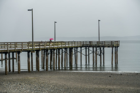 A view of the pier at Redondo Beach, Washington. It is raining. Stock fotó - 80821941