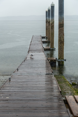 A view of a dock in Redondo Beach, Washington. It is raining. Stock fotó - 80861438