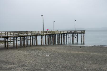 A view of the pier at Redondo Beach, Washington. It is raining.