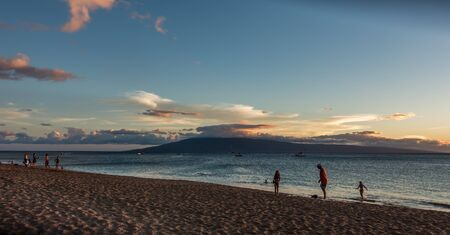 A view of Lanai from a beech in Maui, Hawaii. The sun has set.