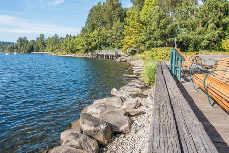A view of the shoreline at Gene Coulon Park in Renton, Washington. Фото со стока - 86868127
