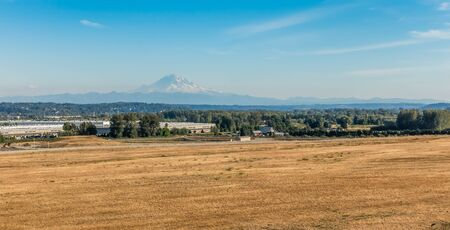 A view of Mount Rainier from Kent, Washington in late summer. Stock Photo