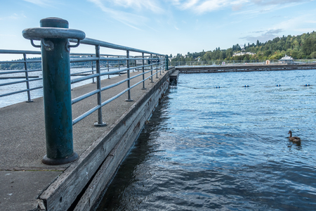 A view of a pier at Gene Coulon Park in Renton, Washington. Фото со стока - 87163963
