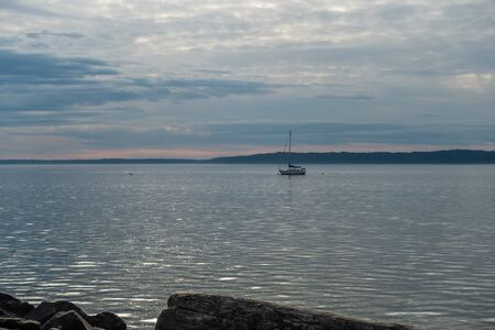 A view of a boat anchored on the Puget Sound on an overcast day. Reklamní fotografie