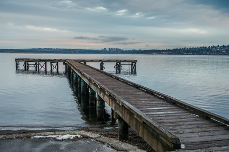 A view of a pier and the Bellevue, Washington skyline.