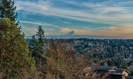 A view of Mount Rainier and wispy clouds. Photo taken in Burien, Washington. Stock Photo